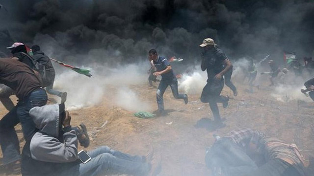 Israeli Gunfire Wounded 14 Palestinian