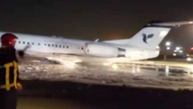 Plane Catches Fire at Tehran Airport