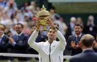 Djokovic Lifts Wimbledon Trophy After Gripping Final