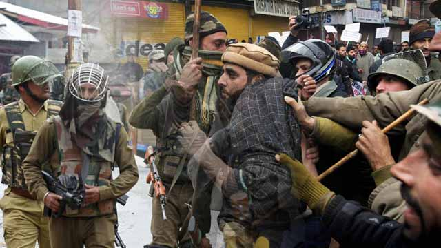 Dozens Arrested as Restrictions Continue in Kashmir