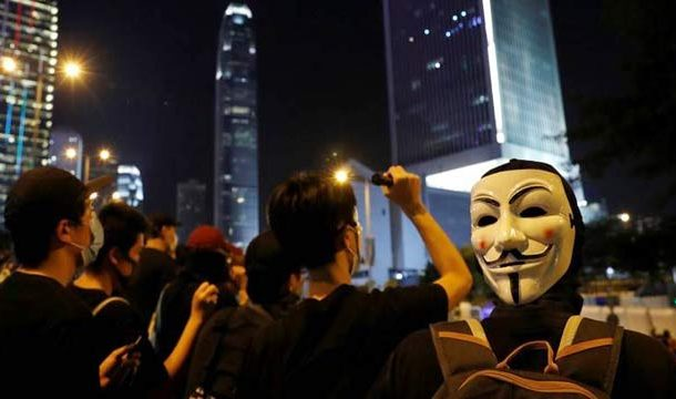 Hong Kong to Impose Ban on Face Masks at Protests