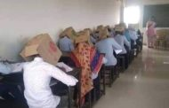 Indian Students Forced To Wear Boxes On Their Heads