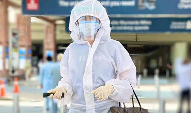 Sana Javed Respects Health Care Staff as she Goes in a Hazmat Suit to the Airport.
